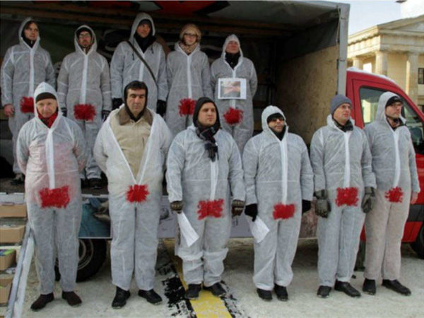 Eleven activists in Germany wear the bloodstained suit to protest penis mutilation